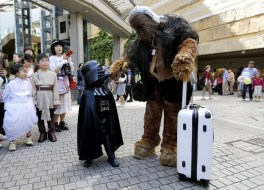 "Cosplayers dressed as ""Star Wars"" characters Chewbacca and Darth Vader talk at a Star Wars Day fan event in Tokyo"