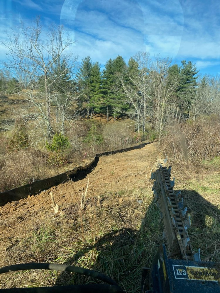 Silt fence installed as an erosion control measure in Weaverville, NC.