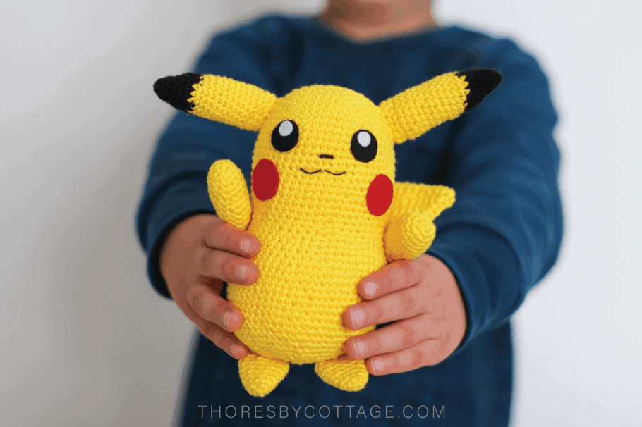 Crochet Pikachu held forward by an excited child