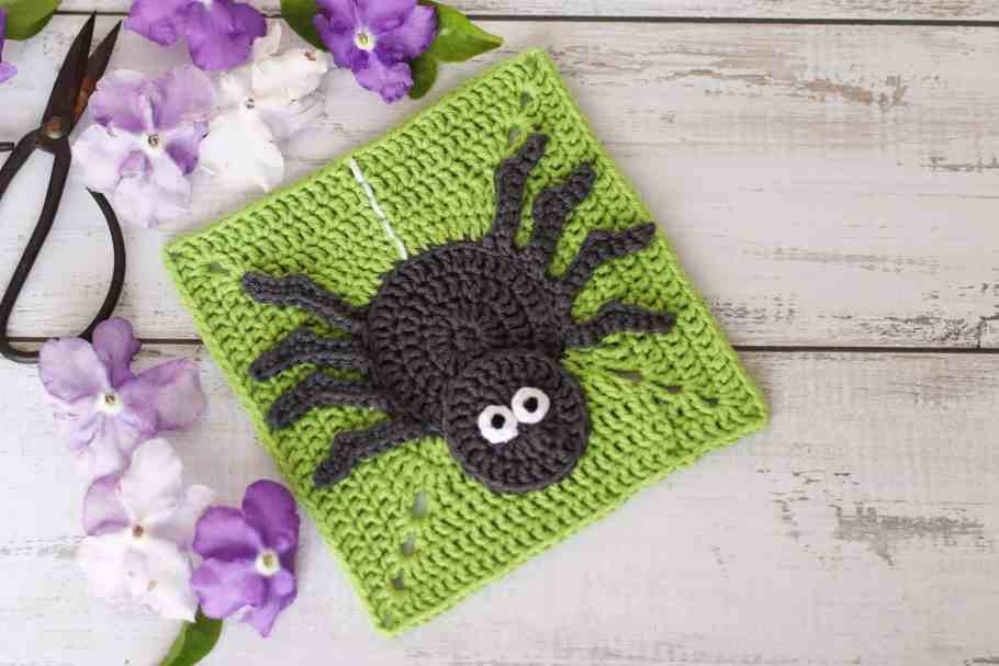 Grey crochet spider on a lime green background