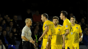 Rovers players crowd around the referee on their last visit to Roots Hall.