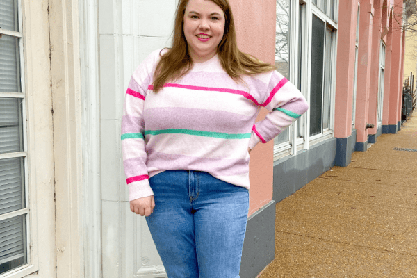 winter to spring transition outfit with a striped sweater and medium wash jeans