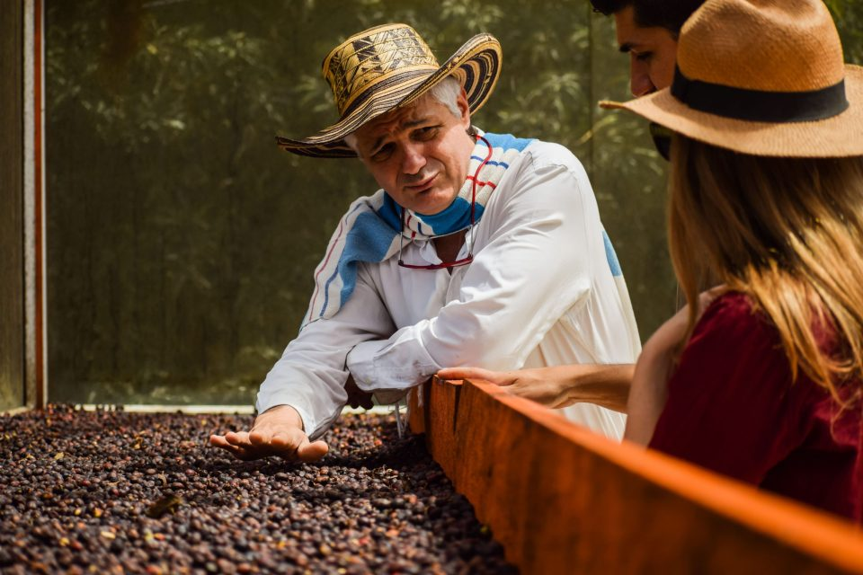 Colombian farmer with coffee beans