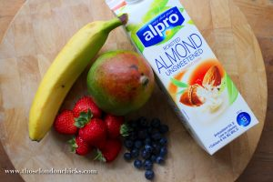 almond-milk-smoothie-recipe-ingredients-mango-banana-strawberry-blueberry-blueberries-wood-choppingboard-chopping-board