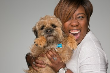 actress-smiling-luging-chizzy-akudolu-dog-border-terrier