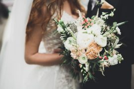 Luxury-wedding-bouquet-n-brides-and-groom-hands