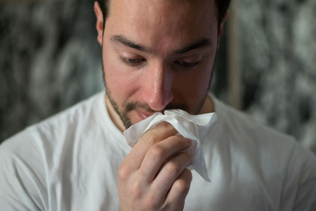man-blowing-nose-allergy-free-home
