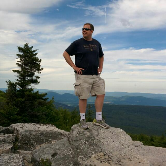 Yours truly standing on a rock in a state park in West Virginia.