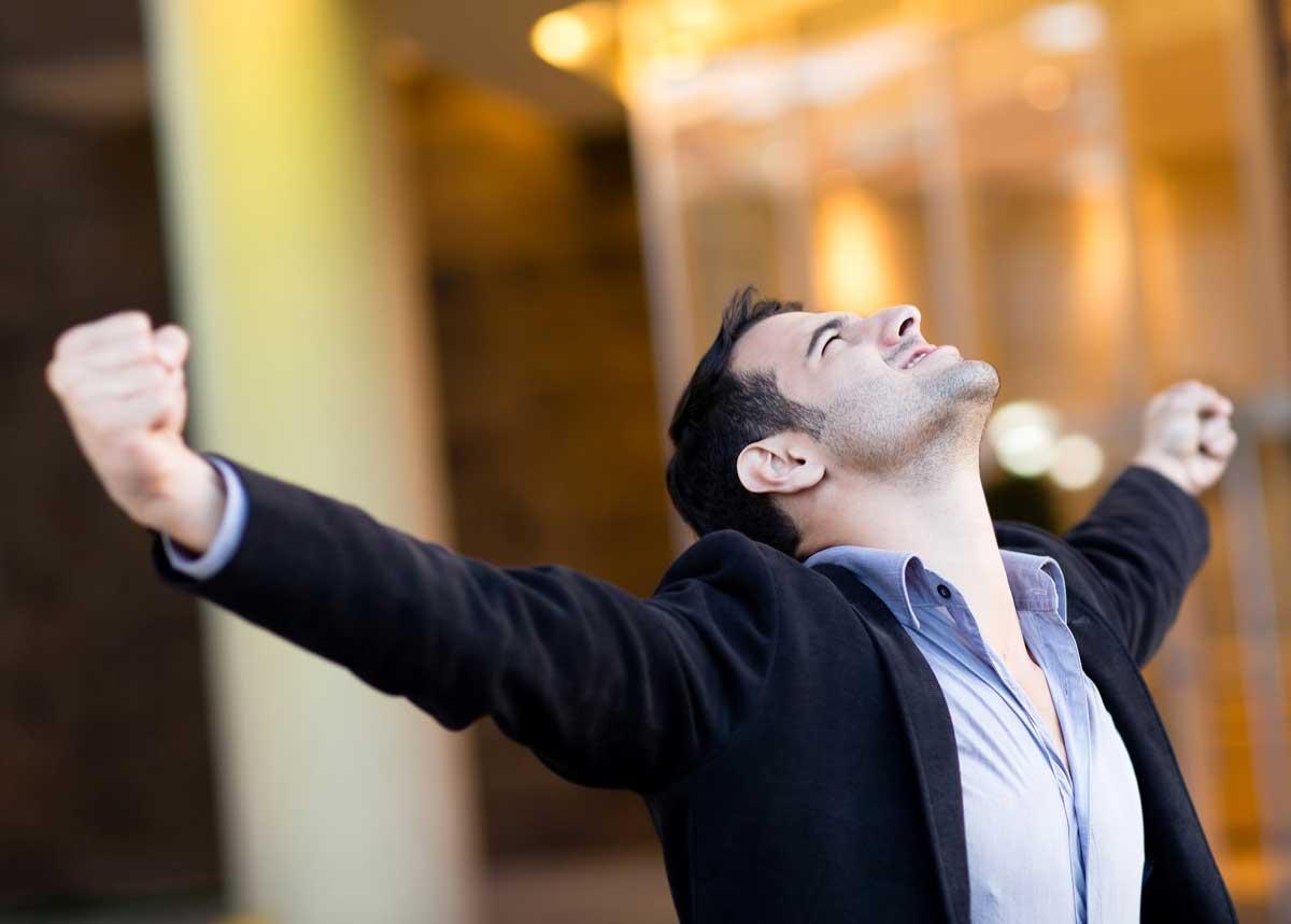 TLL—Successful-businessman-with-ar-33922355