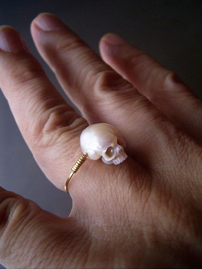 this japanese artist takes beautiful pearls and hand-carves them into adorable 'fairy skulls'