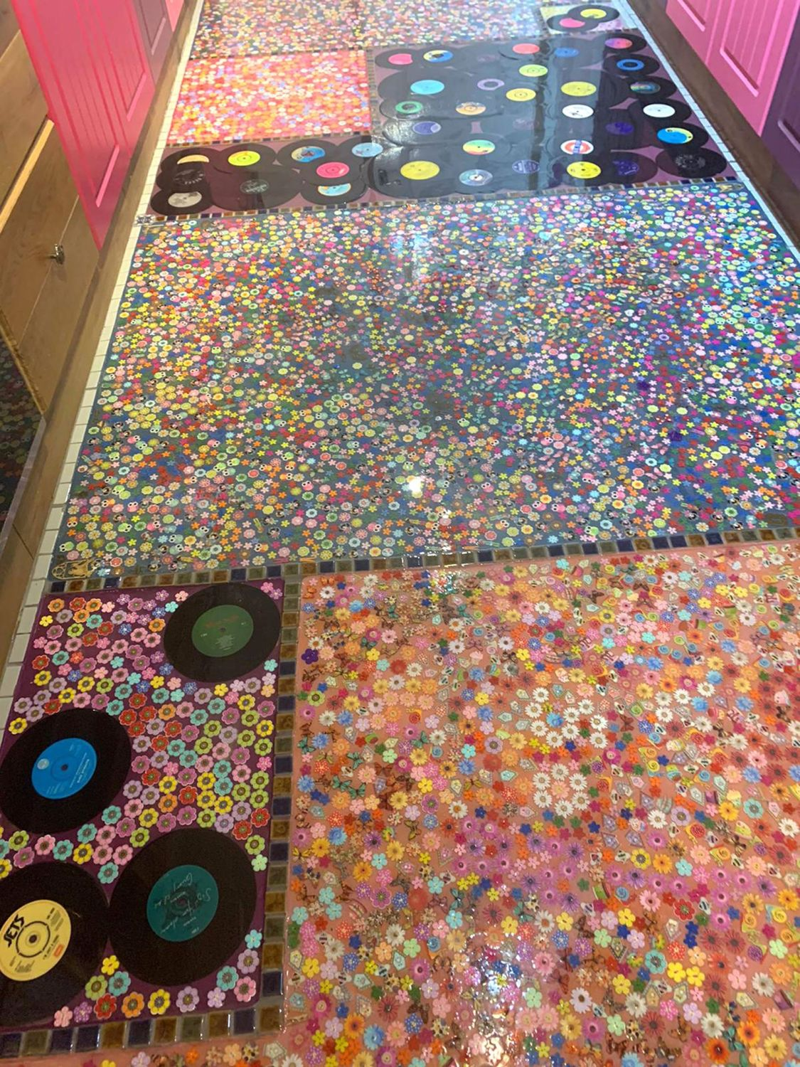 woman turns cheating ex-husband's vinyl records into her kitchen floor