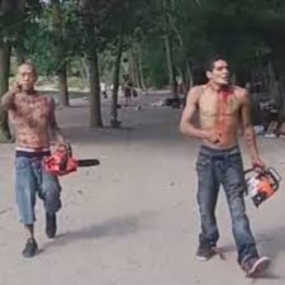 blood-covered men armed with chainsaws tell beachgoers 'you're f****d'