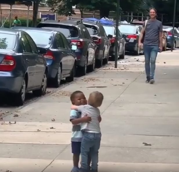 adorable moment as two-year-old best friends run to hug each other on the street after two days apart