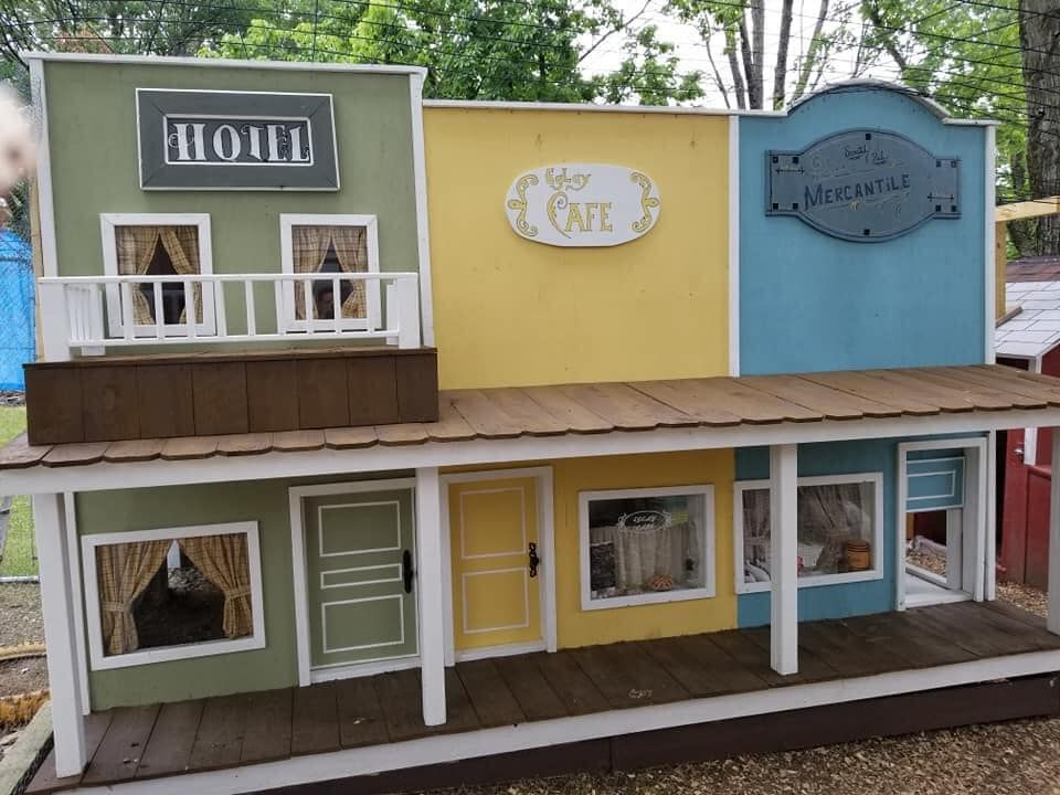 "man builds wife's chickens a mini ""coop town,"" and it's the cutest thing ever"
