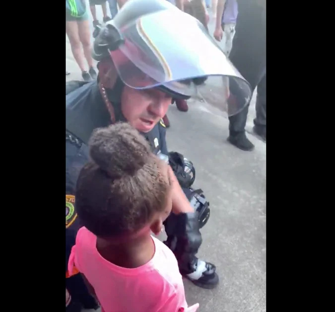 policeman hugs crying black girl who says 'are you gonna shoot us?' during protests
