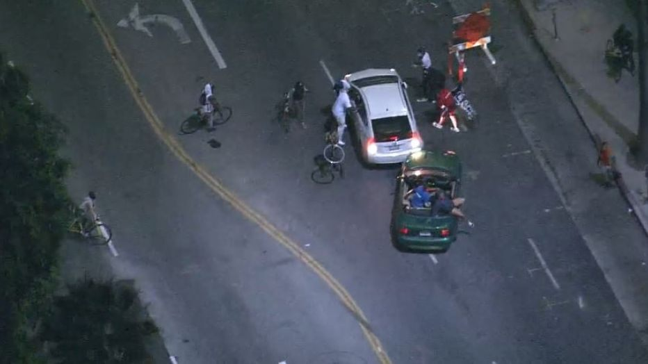 two vehicles hit breonna taylor black lives matter protesters in la
