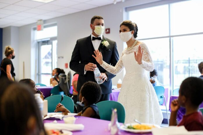 bride and groom didn't just donate wedding food to homeless, they dished it up on their big day