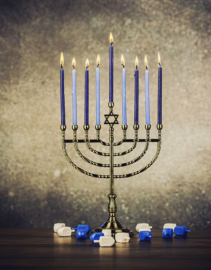 Picture showing a menorah with burning candles to celebrate Hanukkah