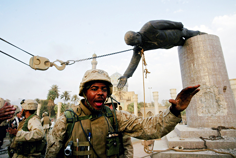 US marines pull down a statue of saddam hussein
