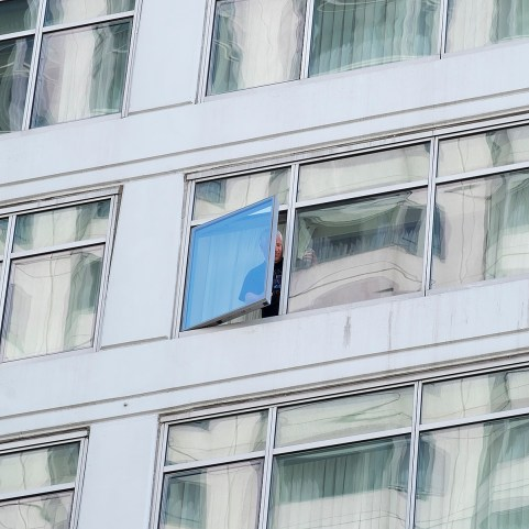 A, possibly, confused hotel guest with an excellent view of the event.