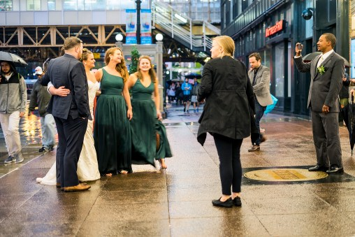 No matter the weather, there's always a wedding photo to be made at the Chicago Theater.