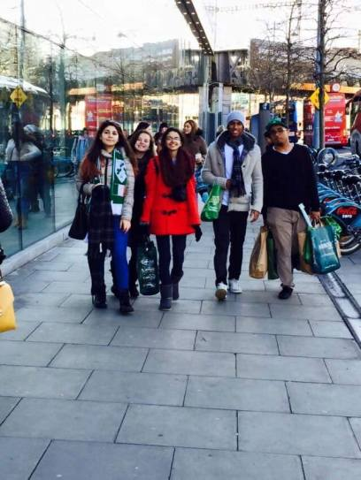 Students from Saudi Arabia walking the streets of Dublin, Ireland after shopping