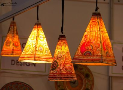 Orange shaded hanging paper lamps