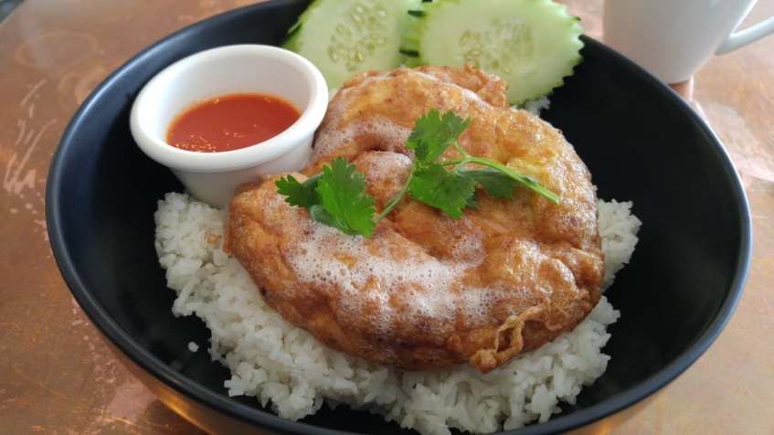 Kai Jiew (Thai style fried omelette) with sticky rice.