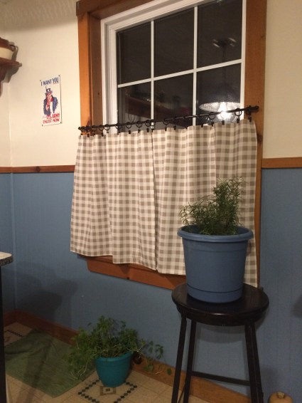 We repainted the kitchen in colors similar to Luke's Diner on Gilmore Girls, I found fabric that looked similar to what Luke's has and made a curtain. The rod and hardware are from Lowe's.