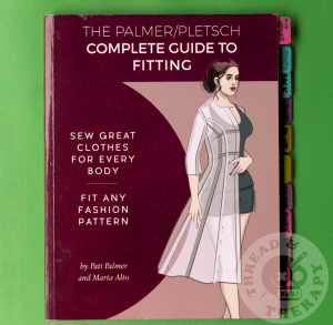 The Palmer/Pletsch Complete Guide to Fitting book against a green backdrop.