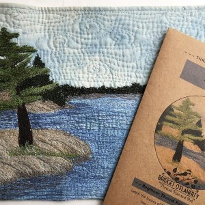 PIne tree on island embroidered with pattern
