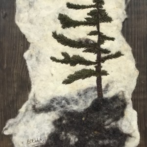 Thread Painted tree on felted background.