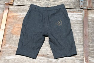 Jana's black linen Jedediah shorts complete with a hand embroidered paper airplane!