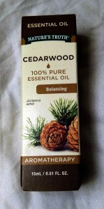 A small box containing a 15mL bottle of cedarwood essential oil.