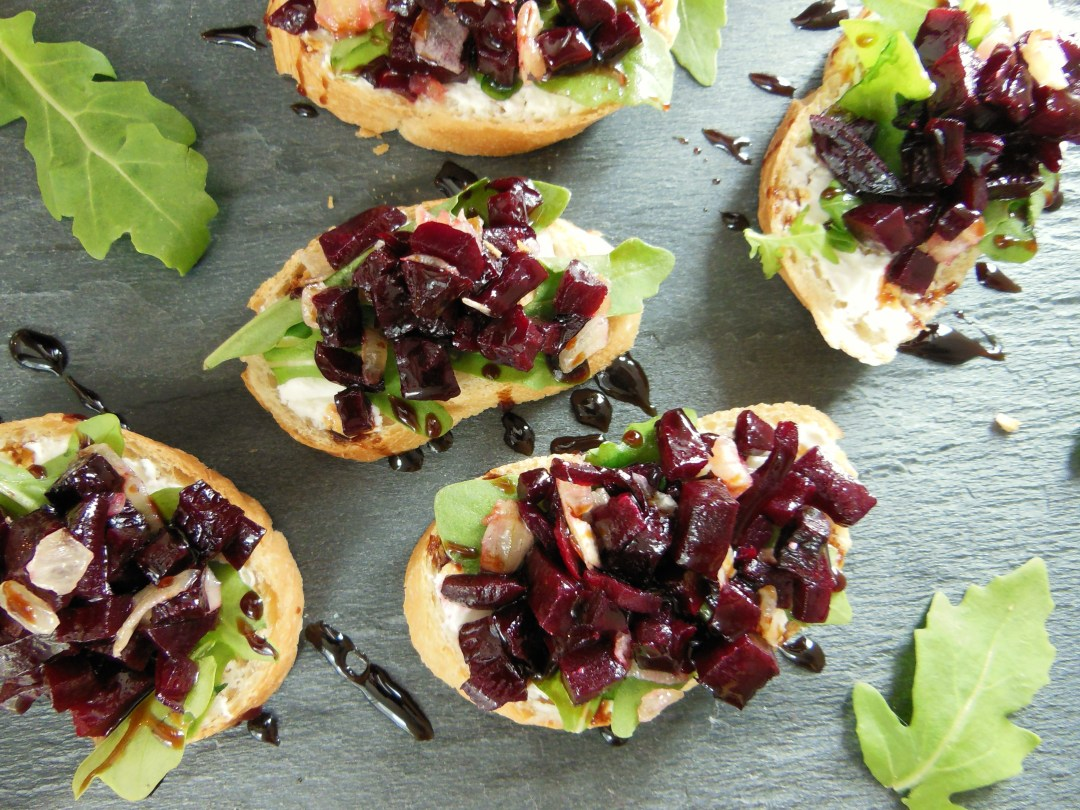 Roasted Beet Bruschetta with Caramelized Onion, Goat Cheese and Arugula
