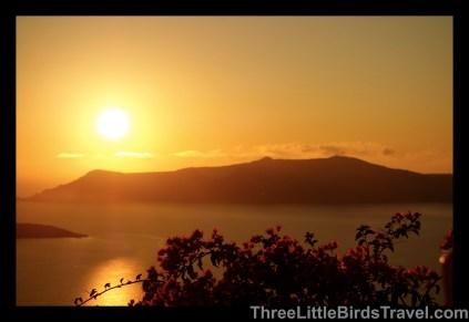 See a sunset in Santorini, Greece