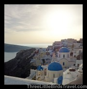 Find the blue domed buildings in Oia - Santorini, Greece