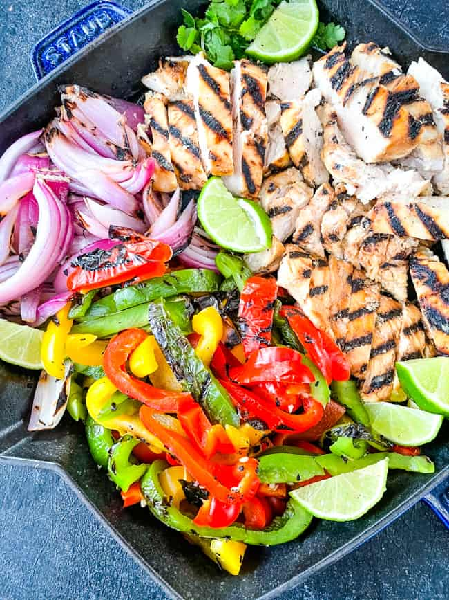 Citrus Chicken Fajitas on the Grill all cut up and placed in a skillet