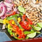 Pin image for Citrus Chicken Fajitas on the Grill in a skillet after they were grilled and cut up with some limes