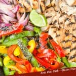Pin image of Citrus Chicken Fajitas on the Grill close up and cut up ready to eat