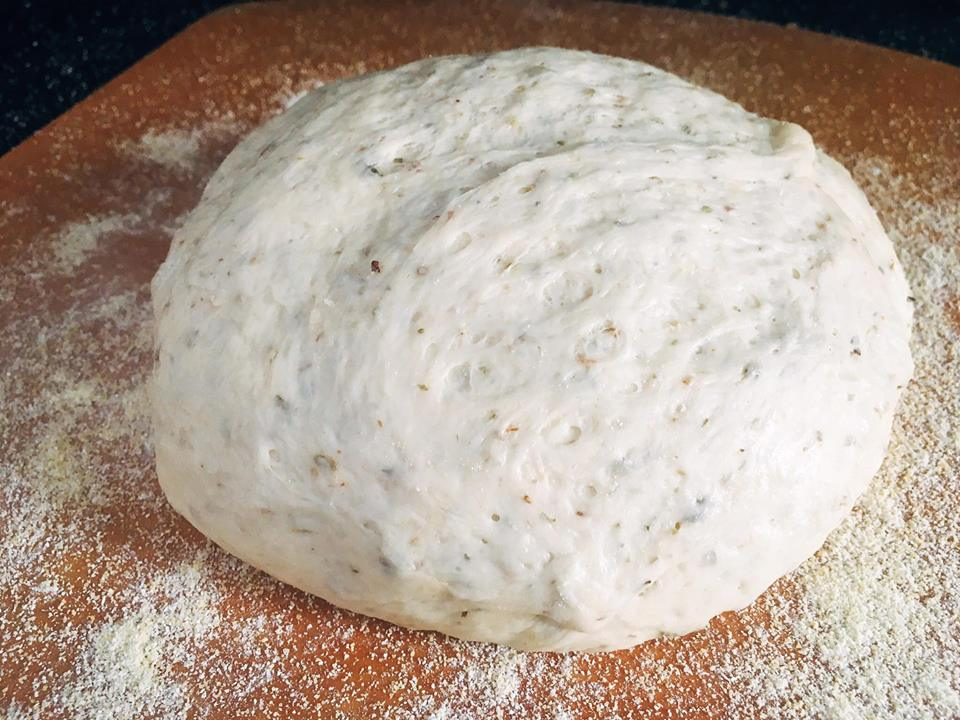 Homemade pizza dough is so easy! Just a few ingredients and minimal kneeding time to get an airy and flavorful pizza crust that you can use with any sauce and topping. You will never want a store bought crust again! Oregano Garlic Pizza Dough   Three Olives Branch