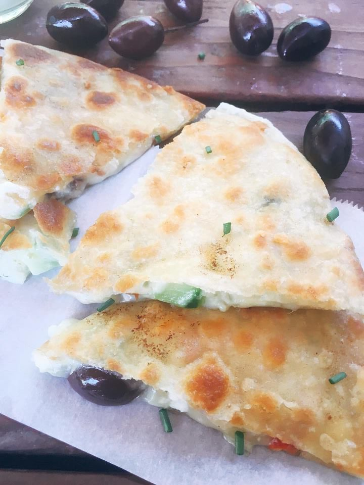 Ready in just 10 minutes! Greek Tzatziki Quesadilla is a great way to sneak some veggies into a fun snack or meal! All the flavors of Greek salad in quesadilla form with some tzatziki sauce inside for extra flavor and dipping. Vegetarian recipe | Three Olives Branch | www.threeolivesbranch.com