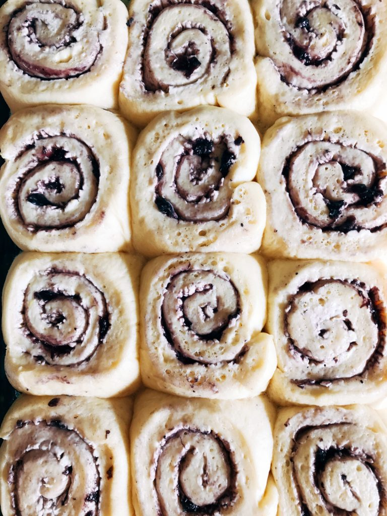 Morning sweet rolls that are perfect for Thanksgiving and holidays. Make the rolls the night before for an easy and fast breakfast. Blueberry and lemon make these vegetarian rolls tart yet sweet. Perfect for breakfast and brunch! Blueberry Lemon Sweet Rolls | Three Olives Branch | www.threeolivesbranch.com