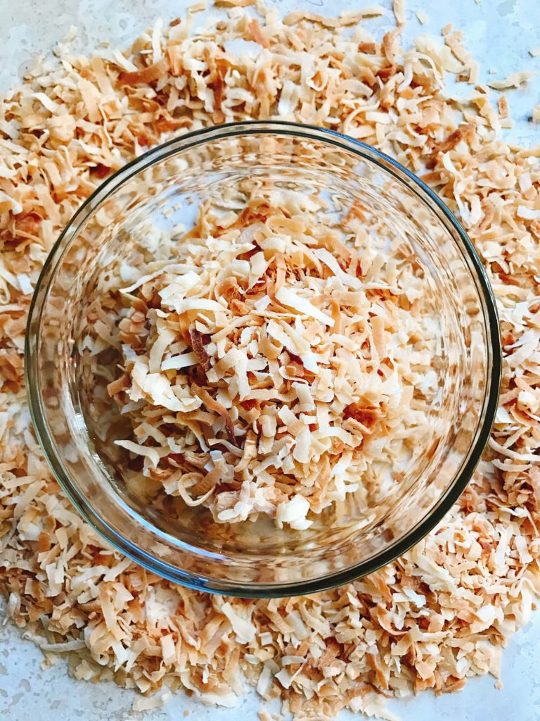 Learn how to make toasted coconut in minutes! Perfect for your holiday baking and desserts. Toasting brings out a nuttiness and texture to coconut. Great for Christmas cookies and baking, snacks, breakfasts, and all types of desserts. Make as much as you need! Vegan and vegetarian. Fast and easy. How to Toast Coconut | Three Olives Branch | www.threeolivesbranch.com