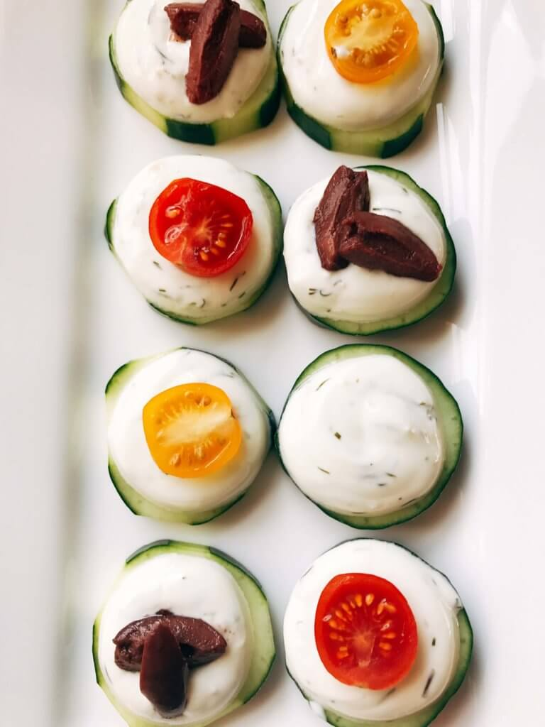 Ready in 10 minutes, these fresh bites are perfect for entertaining, game day appetizer, and parties. A fresh and light snack that is healthy and vegetarian. Simple, fast, and easy to make. Great for football and Super Bowl. Greek Tzatziki Bites | Three Olives Branch | www.threeolivesbranch.com