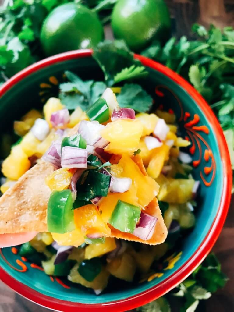 Ready in 10 minutes, this fun and unique salsa is a perfect twist on pico! Great for a cookout, barbecue, party appetizer, and more! Eat it plain or on BBQ chicken or pork for a fun and unique dish. Gluten free, paleo, Whole 30, vegan, vegetarian. Pineapple Serrano Salsa   Three Olives Branch   www.threeolivesbranch.com