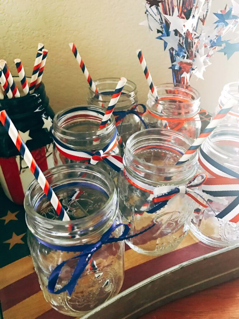 Patriotic Mason Jars for Drinks Station - Simple ideas and tips for Hosting a Patriotic Party including the menu we served! Chicken and Vegetarian Banh Mi Burgers featuring sweet chili sauce, Vietnamese Pickled Vegetable Rice Noodle Salad, BLT Panzanella, and Raspberry Rose (Frose) Popsicles. A perfect summer BBQ or grilling dinner party theme to celebrate the USA and American heritage. Hosting a Patriotic Party | Three Olives Branch | www.threeolivesbranch.com