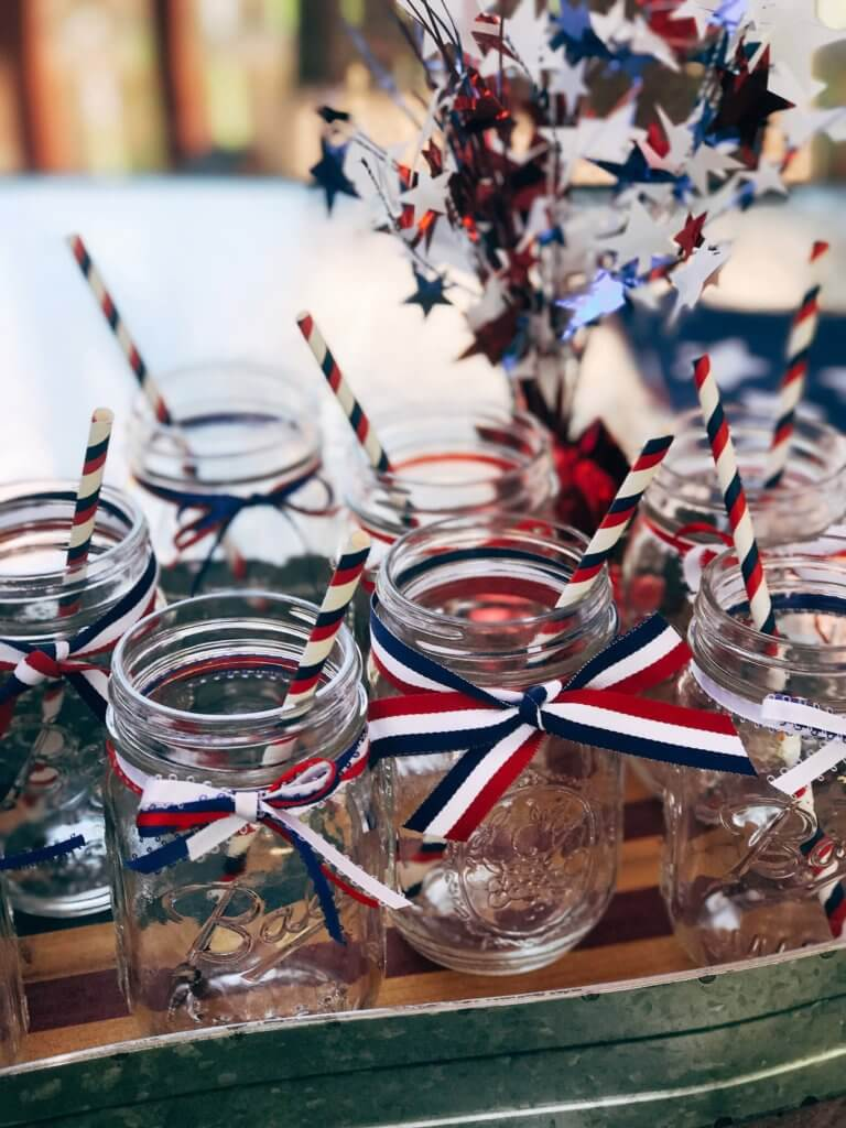 Patriotic Mason Jars for Drinks - Simple ideas and tips for Hosting a Patriotic Party including the menu we served! Chicken and Vegetarian Banh Mi Burgers featuring sweet chili sauce, Vietnamese Pickled Vegetable Rice Noodle Salad, BLT Panzanella, and Raspberry Rose (Frose) Popsicles. A perfect summer BBQ or grilling dinner party theme to celebrate the USA and American heritage. Hosting a Patriotic Party | Three Olives Branch | www.threeolivesbranch.com