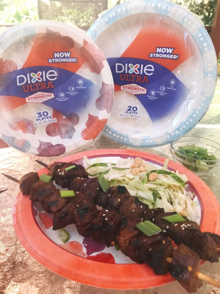 Simple steak skewers perfect for a summer BBQ or event like 4th of July, Memorial Day, and Labor Day. soy sauce, ginger, brown sugar, and more make a sticky marinade that is perfect for beef. Served with a tangy peanut slaw, this dish lets you have a delicious dinner with minimal effort. Use Dixie Ultra Plates for a quick cleanup! Kid friendly. Asian Steak Skewers with Peanut Slaw | Three Olives Branch | www.threeolivesbranch.com