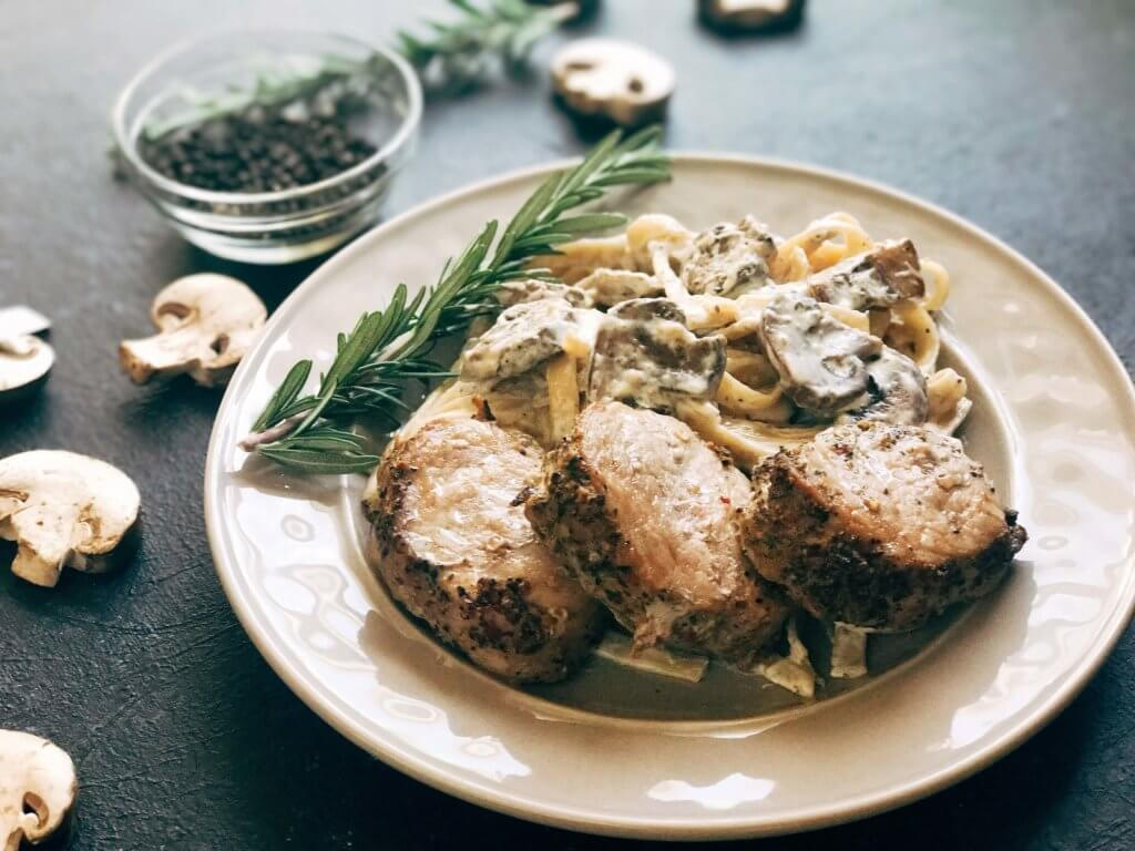 25 minutes to makes these marinated pork medallions and creamy mushroom pasta. Smithfield Roasted Garlic and Cracked Peppercorn Tenderloin Marinated Pork is a quick and easy meal solution for busy families any night of the week. The pasta is made from cream, mushrooms, garlic, and cracked black pepper. Fast, simple, and easy comfort food. Pork Medallions with Creamy Peppercorn Mushroom Pasta | Three Olives Branch | www.threeolivesbranch.com